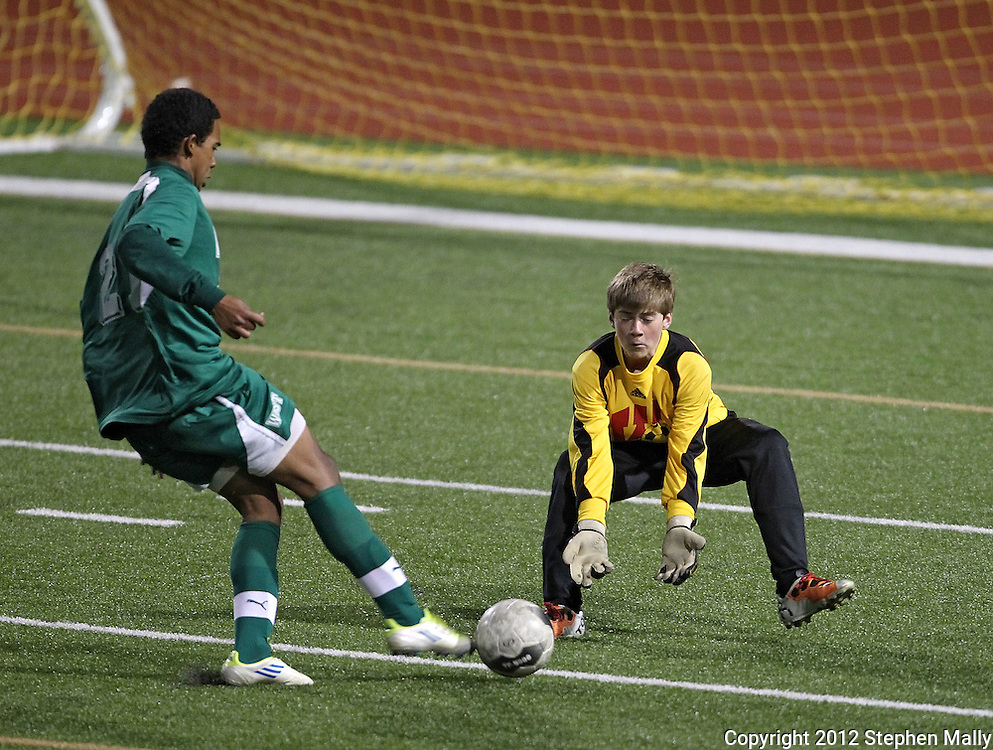 West's Marco Cacho (21) tries to shoot the ball around Washington's Gunnar Lenzen (00) during the game between Iowa City West and Cedar Rapids Washington at Kingston Stadium in Cedar Rapids on Monday evening, April 9, 2012. Washington won 3-2. (Stephen Mally/Freelance)