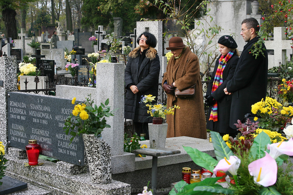 Ewa Ledochowicz family, All Saints Day. Lodz, Poland. Visiting one of many family member's graves.