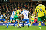 Norwich City midfielder Todd Cantwell (36) tries to thread his way through the Portsmouth defence but is tackled by Portsmouth defender Matthew Clarke (5) during the The FA Cup 3rd round match between Norwich City and Portsmouth at Carrow Road, Norwich, England on 5 January 2019.