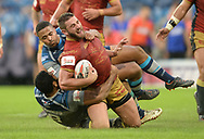 Julian Bousquet of Catalans Dragons is tackled by Jordan Turner during the Ladbrokes Challenge Cup match at the John Smiths Stadium, Huddersfield<br /> Picture by Richard Land/Focus Images Ltd +44 7713 507003<br /> 31/05/2018