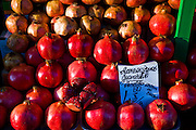 Pomegranates displayed at the Central Market in Riga, Latvia.  Riga's Central Market, established in 1201, is one of Europe's largest and most ancient markets.