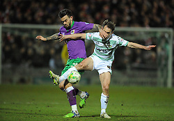 Bristol City's Marlon Pack is tackled by Yeovil Town's James Hayter  - Photo mandatory by-line: Harry Trump/JMP - Mobile: 07966 386802 - 10/03/15 - SPORT - Football - Sky Bet League One - Yeovil Town v Bristol City - Huish Park, Yeovil, England.