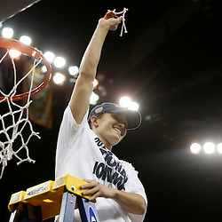 Apr 9, 2013; New Orleans, LA, USA; Connecticut Huskies guard Kelly Faris (34) celebrates after cutting the net after the championship game in the 2013 NCAA womens Final Four against the Louisville Cardinals at the New Orleans Arena. Connecticut defeated Louisville 93-60. Mandatory Credit: Derick E. Hingle-USA TODAY Sports