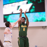 3rd year forward Shaquille Harris (6) of the Regina Cougars during the Men's Basketball home game on November 25 at Centre for Kinesiology, Health and Sport. Credit: Casey Marshall/Arthur Images
