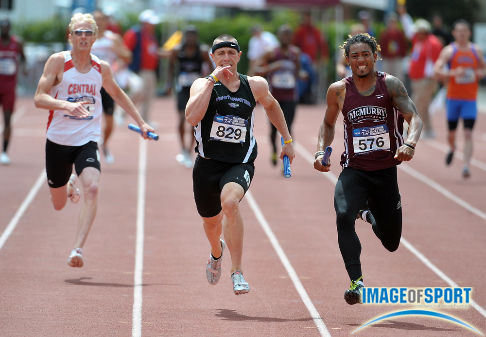 May 26, 2012; Claremont, CA, USA; Kenneth Turner of McMurry (right) holds off Nick Bee of Whitewater (center) on the anchor of the 4 x 100m relay, 40.62 to 40.66, and Allen Scovel of Central College (left) in the 2012 NCAA Division III Track & Field Championships at Claremont-Mudd-Scripps College.
