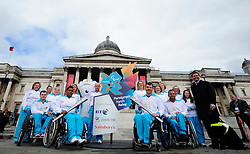 © Licensed to London News Pictures. 15/05/2012. London,Britain. The first team of Torchbearers chosen to carry the Flame during the Paralympic Torch Relay pose at Trafalgar Square . Photo credit : Thomas Campean/LNP