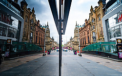 Glasgow, Scotland, UK. 1 April, 2020. Effects of Coronavirus lockdown on streets of Glasgow, Scotland. A deserted Buchanan Street reflected in a shop window. Iain Masterton/Alamy Live News
