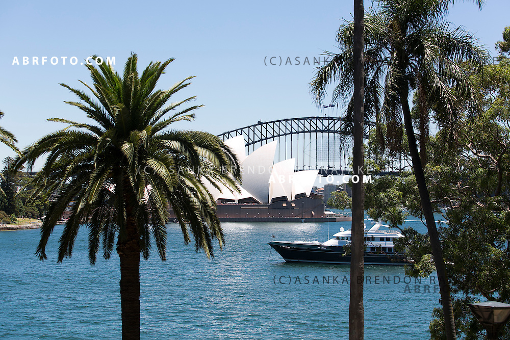 General view of the Sydney Harbour with the Sydney Harbour Bridge and Opera house in the background viewed from the Royal Botanic Gardens