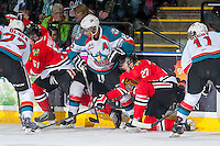 KELOWNA, CANADA - APRIL 25: Oliver Bjorkstrand #27 of the Portland Winterhawks falls the ice while digging for the puck against Tyrell Goulbourne #12 of the Kelowna Rockets on April 25, 2014 during Game 5 of the third round of WHL Playoffs at Prospera Place in Kelowna, British Columbia, Canada. The Portland Winterhawks won 7 - 3 and took the Western Conference Championship for the fourth year in a row earning them a place in the WHL final.  (Photo by Marissa Baecker/Getty Images)  *** Local Caption *** Oliver Bjorkstrand; Tyrell Goulbourne;