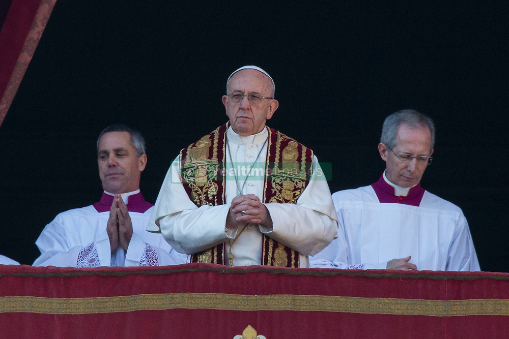 """Pope Francis delivers his traditional Christmas Message and """"Urbi et Orbi"""" Blessing from the balcony of St Peter's basilica at Saint Peter's Square in Vatican City on December 25, 2017. 25 Dec 2017 Pictured: Pope Francis on the balcony of St Peter's basilica during the traditional """"Urbi et Orbi"""" Christmas Blessing at Saint Peter's Square in Vatican City on December 25, 2017. Photo credit: Stefano Costantino / MEGA TheMegaAgency.com +1 888 505 6342"""
