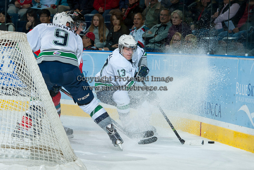 KELOWNA, CANADA - OCTOBER 11:   Mathew Barzal #13 of the Seattle Thunderbirds steals the puck at  the Kelowna Rockets on October 11, 2013 at Prospera Place in Kelowna, British Columbia, Canada (Photo by Marissa Baecker/Shoot the Breeze) *** Local Caption ***