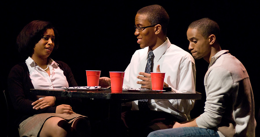 "LEST WE FORGET -- ""Pamela Baker"" (left, played by Erin Waddles), ""Dr. Baker"" (Patrick Easley) and ""Mike"" (Joshua Bridges), all students from Washington University in St. Louis, have lunch during a scene from Black Anthology 2012 ""Lest We Forget"" at Edison Theatre on the Danforth Campus in St. Louis Friday, Feb. 3, 2012. Photo by Sid Hastings © copyright 2012 Washington University in St. Louis."