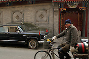 Beijing, China -  December 9 , 2005 - A Red Flag Limo that once belonged to Mao Zedong's wife,  Jiang Qing is parked outside of the Beijing Capital Club Restaueant, in a 200-year-old courtyard compounds in Beijing's Dongcheng district. The proprietor, Lawrence Brahm has seized upon a romanticized notion of China at the cusp of revolution and turned it into a luxury-entertainment brand that appeals not only to visiting foreigners with a sense of irony but also to young Chinese and old generals.