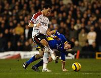Photo: Daniel Hambury.<br />Fulham v Tottenham Hotspurs. Barclays Premiership. 31/01/2006.<br />Fulham's Liam Rosenior and Tottenham's Andy Reid battle.