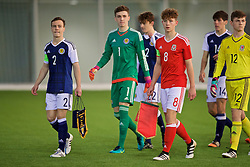 EDINBURGH, SCOTLAND - Tuesday, November 1, 2016: Wales' captain Terry Taylor and Scotland's captain Chris Hamilton lead their sides out to before the Under-16 2016 Victory Shield match at ORIAM. (Pic by David Rawcliffe/Propaganda)