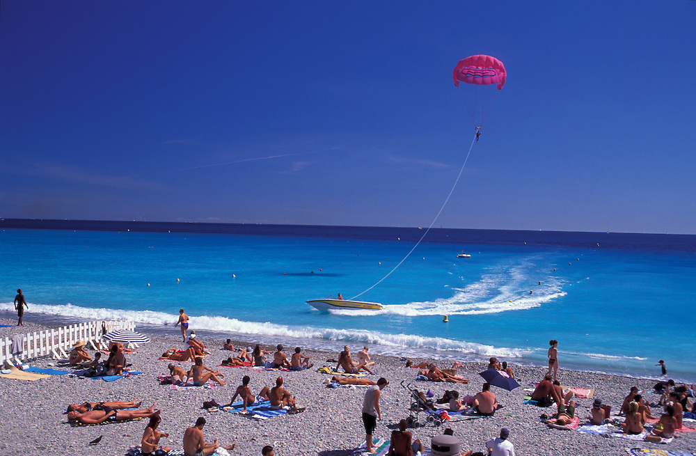Parasailing and sunbathing, People at Beach, Nice, Provence Alpes Cote d'Azur, France