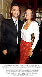HENRY & LILI DENT-BROCKLEHURST, he is the Godson of Camilla Parker Bowles, at a party in London on 13th May 2002.	OZY 33