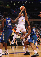 June 10, 2010; Phoenix, AZ, USA; Phoenix Mercury guard Temeka Johnson puts up a basket during the second half in at US Airways Center.  The Mercury defeated the Lynx 99-88.  Mandatory Credit: Jennifer Stewart-US PRESSWIRE