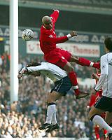 Photo: Scott Heavey/Sportsbeat<br />Tottenham Hotspur v Liverpool. 16/03/03.<br />Liverpools El-Hadji Diouf takes a ride on th back of Mauricio Taricco during this premiership clash at White Hart Lane.