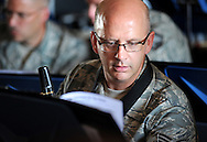 23 JUNE 2012 -- ST. LOUIS -- Missouri Air National Guard Tech Sgt. Paul Holzen studies his score during a rehearsal of the 571st Air Force Band at Lambert Field in St. Louis Saturday, June 23, 2012. The group, which is attached to the 131st Fighter Wing of the Eighth Air Force, was organized in 1941 and has been based in St. Louis since 1946.  It is being hosting a final tour of the Midwest this summer, and will be decommissioned in September 2013. Photo © copyright 2012 Sid Hastings.