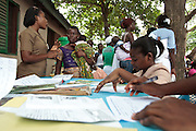 Ghana: 25 April 2012, A nurse speaks with a woman about her child's vaccination schedule at the Dodowa new town health outreach point in Dodowa.The GAVI Alliance is a public-private partnership that brings together developing country and donor governments, WHO, UNICEF, the World Bank, the vaccine industry in both industrialised and developing countries, research and technical agencies, civil society, the Bill & Melinda Gates Foundation and other private philanthropists.  Set up in 2000 as the Global Alliance for Vaccines and Immunisation, GAVI's mission is to save children's lives and protect people's health by increasing access to immunisation in the world's poorest countries.