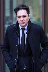 Julian Manea, 36, appears to wink at the camera outside Westminster Magistrates Court in London where he faces allegations of stalking Veronica Bisquert and sharing 'revenge porn'. Westminster Magistrates Court, London, February 15 2018.