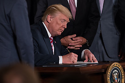 June 5, 2017 - Washington, DC, United States - President Donald Trump signed a letter of principal that would privatize  the air traffic control functions of the Federal Aviation Administration, in the East Room of the White House, on Monday, June 5, 2017. (Credit Image: © Cheriss May/NurPhoto via ZUMA Press)