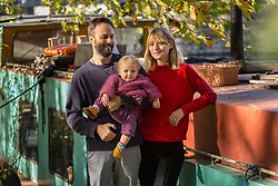 Mail Online: Couple Kim Marren, 31, a model and partner Maarten Ketels and actor together with their one-year-old daughter Willow next to their barge Sunshine which started out as an empty shell and is now a small but comfortable home currently moored on the Lea Navigation in East London. North Hackney, London, November 02 2018.