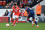 Rico Henry plays the ball during the Sky Bet League 1 match between Walsall and Doncaster Rovers at the Banks's Stadium, Walsall, England on 12 September 2015. Photo by Alan Franklin.