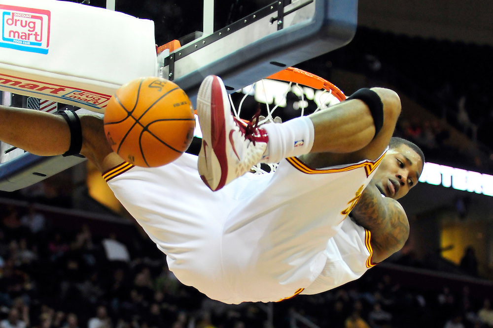 Feb. 2, 2011; Cleveland, OH, USA; Cleveland Cavaliers shooting guard Alonzo Gee (33) hangs on to the rim after a dunk during the second quarter against the Indiana Pacers at Quicken Loans Arena. Mandatory Credit: Jason Miller-US PRESSWIRE