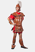 Full length of an old fashioned soldier against gray background