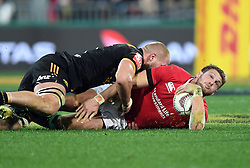"""Brad Shields of the Hurricanes, left, tackles Dan Biggar of the Lions in the International rugby match between the the Super Rugby Hurricanes and British and Irish Lions at Westpac Stadium, Wellington, New Zealand, Tuesday, June 27, 2017. Credit:SNPA / Ross Setford  **NO ARCHIVING"""""""