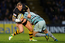 Wasps replacement (#23) Lee Thomas is tackled by Leicester Number 8 (#8) Thomas Waldrom during the second half of the match - Photo mandatory by-line: Rogan Thomson/JMP - Tel: Mobile: 07966 386802 25/11/2012 - SPORT - RUGBY - Adams Park - High Wycombe. London Wasps v Leicester Tigers - Aviva Premiership.