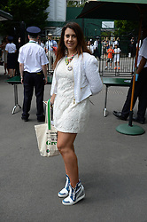 © Licensed to London News Pictures. 24/06/2014. London, UK . Wimbledon Tennis Championships 2014<br /> Day 2. Marion Bartoli.  Photo credit : Mike King/LNP