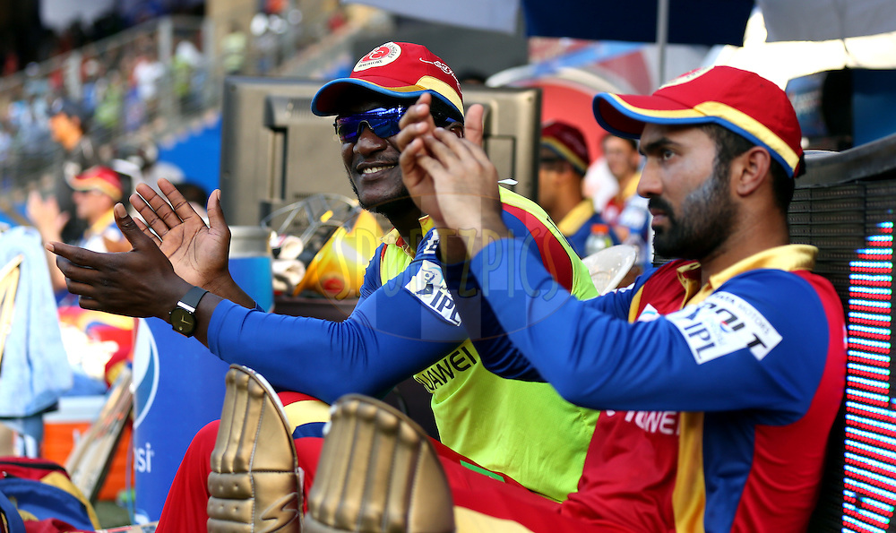 Royal Challengers Bangalore player Daren Sammy and Royal Challengers Bangalore player Dinesh Karthik during match 46 of the Pepsi IPL 2015 (Indian Premier League) between The Mumbai Indians and The Royal Challengers Bangalore held at the Wankhede Stadium in Mumbai, India on the 10th May 2015.<br /> <br /> Photo by:  Sandeep Shetty / SPORTZPICS / IPL