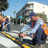 Crew from the City of Santa Monica Public Works Traffic Division install a new Dura-Curb at Ocean and Bicknell Ave on Tuesday, January 31, 2012. The Dura-Curb was installed due to continuous illegal u-turns.