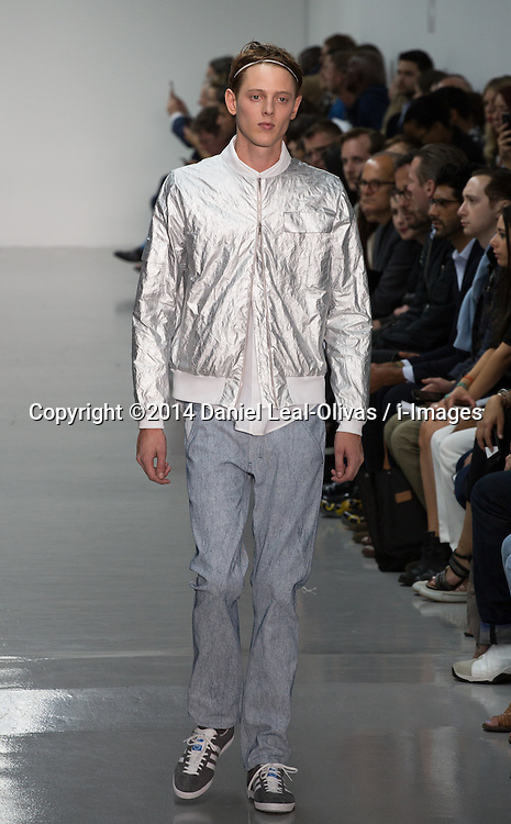Image ©Licensed to i-Images Picture Agency. 15/06/2014. London, United Kingdom. London Collections: Men. A model presents a creation by Richard Nicoll during the first day of the Spring/Summer 2015 \'London Collections: Men\' fashion event in London. The Old Shorting Office. Picture by Daniel Leal-Olivas / i-Images