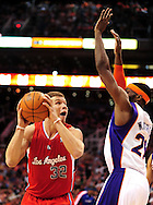 Apr. 1, 2011; Phoenix, AZ, USA; Los Angeles Clippers forward Blake Griffin (32) handles the ball against the Phoenix Suns forward Hakim Warrick (21) at the US Airways Center. Mandatory Credit: Jennifer Stewart-US PRESSWIRE
