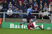 Peter Spurrier Sports  Photo.email pictures@rowingpics.com.Tel 44 (0) 7973 819 551.Nationwide Division 2 .Wycombe Wanders FC v Swindon Town FC..27-10-2001.1st Half..Wycombe's Stuart Roberts jumps over Swindon's Matty Hewlett.
