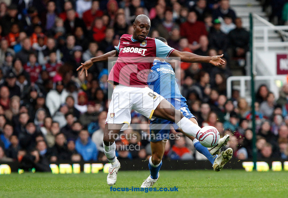 Picture by Daniel Chesterton/Focus Images Ltd. 07966 018899.09/04/12.Carlton Cole of West Ham and Curtis Davies of Birmingham City during the Npower Championship match at the Boleyn Ground stadium, London.