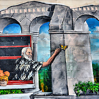 Man Painting Butterfly Mural by David Schuster in Louisville, Kentucky<br />