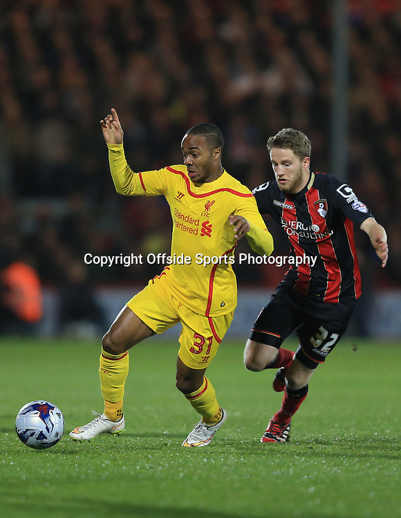 17 December 2014 - Capital One Cup Quarter Final - Bournemouth v Liverpool - Raheem Sterling of Liverpool in action with Eunan O'Kane of Bournemouth - Photo: Marc Atkins / Offside.