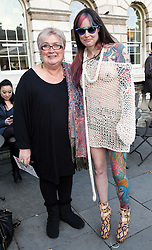 Jenni Murray with fashionista Lisa Reynolds, outside the Somerset House tent  at London Fashion Week , Sunday, 16th February 2014. Picture by Stephen Lock / i-Images