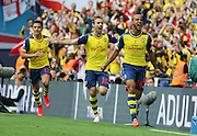 Arsenal's Theo Walcott celebrates his opening goal during the The FA Cup match between Arsenal and Aston Villa at Wembley Stadium, London, England on 30 May 2015. Photo by Phil Duncan.