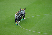 Angers's players observe a minute of silence for the victims of the Manchester terror attack before the French Cup final football during the 100th French Cup, Final football match between SCO Angers and Paris Saint-Germain on May 27, 2017 at Stade de France in Saint-Denis, France - Photo Stephane Allaman / ProSportsImages / DPPI