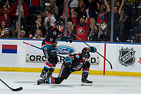 KELOWNA, CANADA - OCTOBER 13:  Ethan Ernst #19 and Dallon Wilton #15 of the Kelowna Rockets celebrate a third period goal against the Tri-City Americans on October 13, 2018 at Prospera Place in Kelowna, British Columbia, Canada.  (Photo by Marissa Baecker/Shoot the Breeze)  *** Local Caption ***
