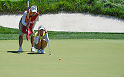 Jul 11, 2015; Lancaster, PA, USA; Chella Choi and caddie Jiyeon Choi line up a putt on the twelfth green during the third round of the 2015 U.S. Women's Open at Lancaster Country Club.