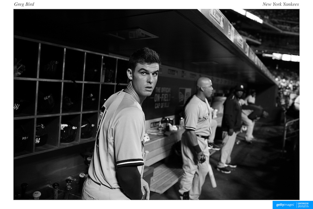 Greg Bird, (left) and Carlos Beltran, New York Yankees, in the dugout preparing to bat during the New York Mets Vs New York Yankees MLB regular season baseball game at Citi Field, Queens, New York. USA. 20th September 2015. Photo Tim Clayton