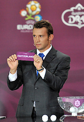 ANDRIY SCHEVCHENKO (UKRAINE) SHOWS THE TICKET OF SWITZERLAND DURING THE EUFA EURO 2012 QUALIFYING DRAW IN PALACE SCIENCE AND CULTURE IN WARSAW, POLAND..THE 2012 EUROPEAN SOCCER CHAMPIONSHIP WILL BE HOSTED BY POLAND AND UKRAINE...WARSAW, POLAND , FEBRUARY 07, 2010..( PHOTO BY ADAM NURKIEWICZ / MEDIASPORT / SPORTIDA.COM ).