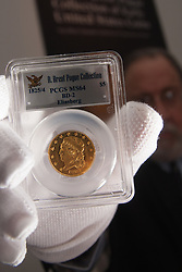 London, March13th 2015. Ahead of the first sale of the D. Brent Pogue rare United States Federal coin  collection sale to be held at Sotheby's  New York. The collection is composed of over 650 gold, silver, and copper coins, and is expected to be the most valuable collection of coins ever sold. PICTURED: The capped bust Quarter Eagle, the finest known example of a one year design, from 1808 which is expected to fetch up to $10 million at auction.